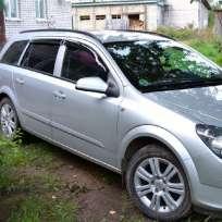 COBRA TUNING Дефлекторы окон на Opel Astra H '04-10 универсал (накладные)